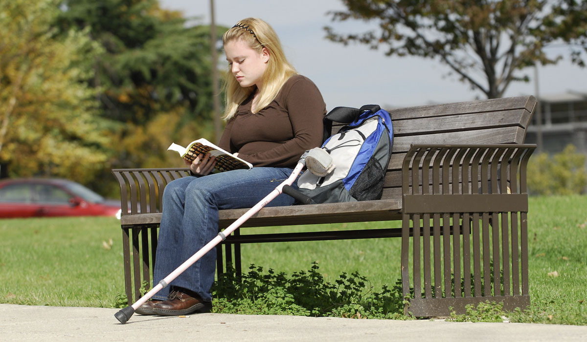 CUA Student with crutch